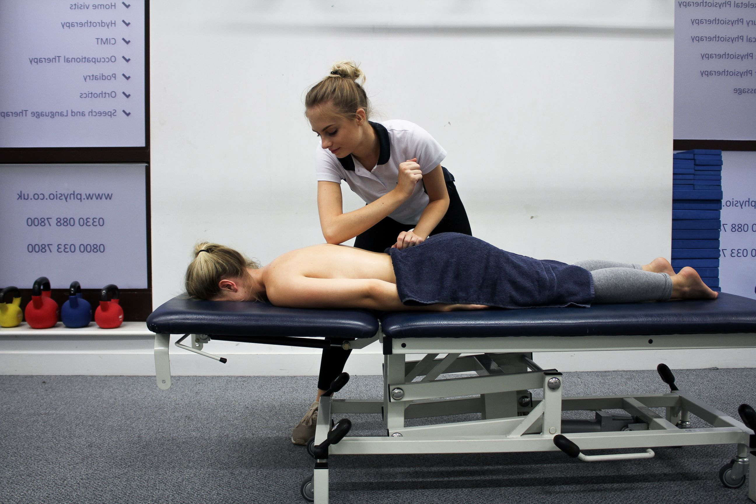 Patient receiving treatment to the back.