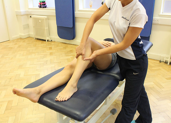 Patient receiving treatment to the knee in Manchester clinic