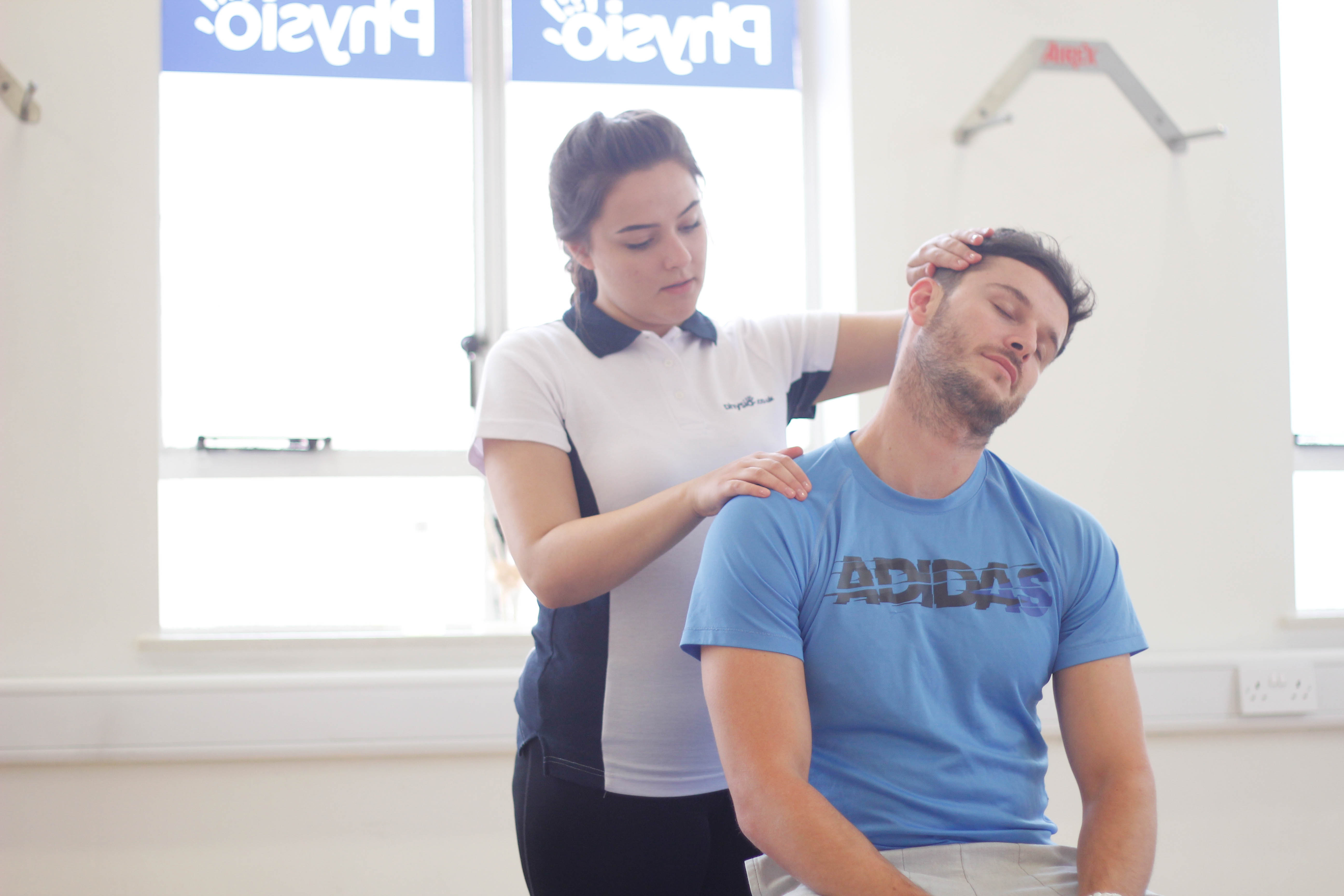 Patient receiving upper body massage in Manchester clinic